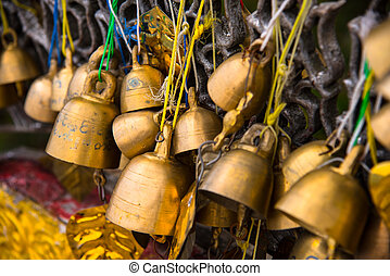 Many golden buddhist bells. - Many golden buddhist bells...