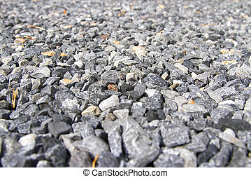 Many granite on the floor during the day.