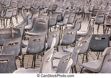 Many gray chairs.