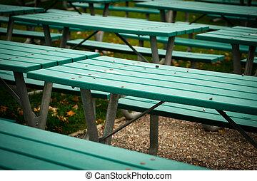 Many Green Picnic Tables - Close-up of many green,...