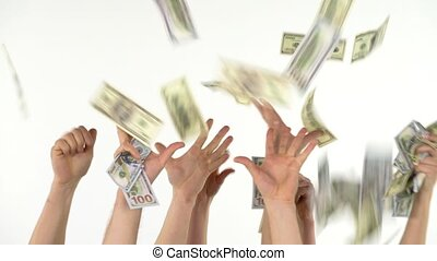 Many hands catch falling US dollars. Slow motion - Many...