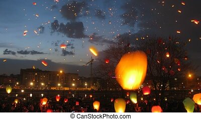 Many heavenly small lanterns fly to night sky, time lapse