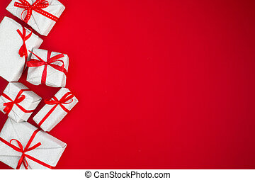 Many holiday gifts on red