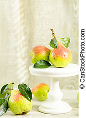 Many juicy beautiful amazing nice pears on light wooden background