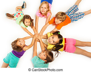 Many kids laying on a floor