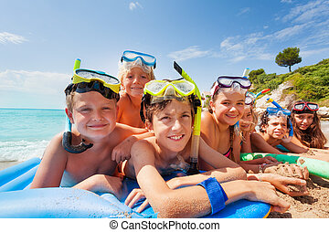 Many kids on the beach at summer vacation