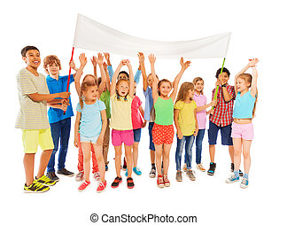 Many kids stand with blank banner