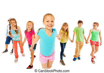 Many kids with happy girl hold hands and pull