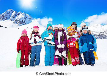 Many kids with ice skates