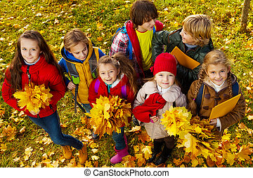 Many kids with maple leaves