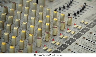 Many Knobs and Buttons on an Old Fashioned Audio Mixer -...