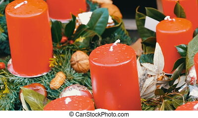 Many large multi-colored Christmas thick wax candles...