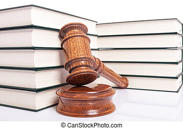 law books and a wooden judges gavel