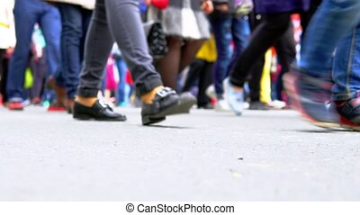 Many legs of people who walk