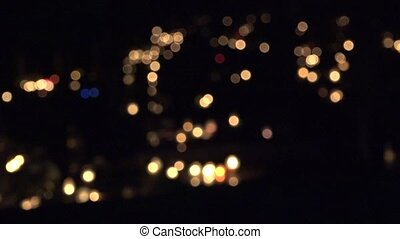 many lighted religion candle on tomb in cemetery evening. -...
