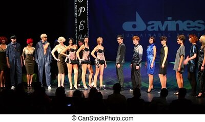 Many models applaud to Tim Hartley and Pavel Sobolev on stage at Davines Hair Show 2010