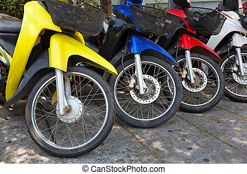 Many motorbikes at the parking near big store