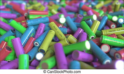 Many multicolor lithium-ion batteries, close-up. 3D animation