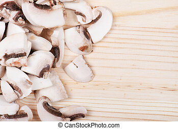 Many mushrooms on wooden table