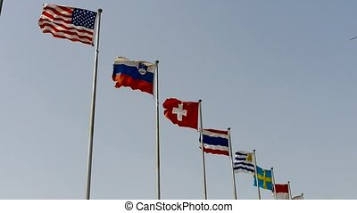 Many national flags fluttering in wind. American-flag.