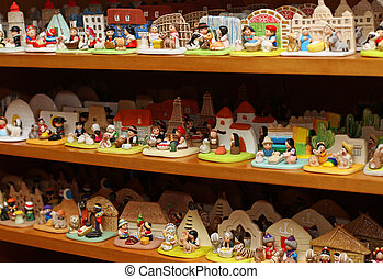 many Nativity scenes from around the world in religious goods store at Christmas 1