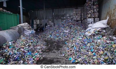 many of old used aluminum cans are lying on a floor of huge...