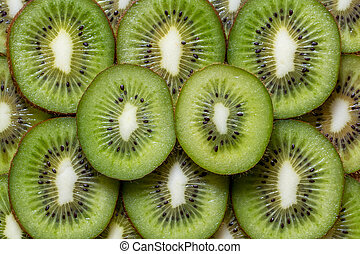 Many of slised kiwi fruit pieces background