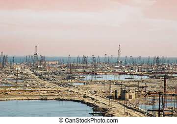 Many oil derricks on the shore near Baku, Azerbaijan