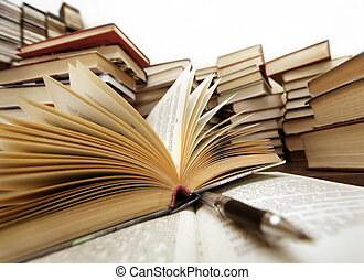 Knowledge - light - Many old books combined by a heap. ...