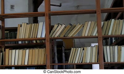 Many old books on the shelves in library