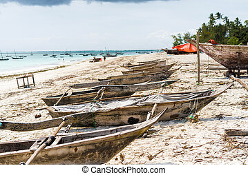 many old fishing boats on african seashore