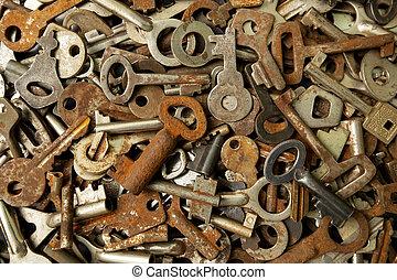 Many old keys, grunge background