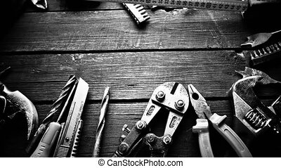Many old rusty tools on repairman desk