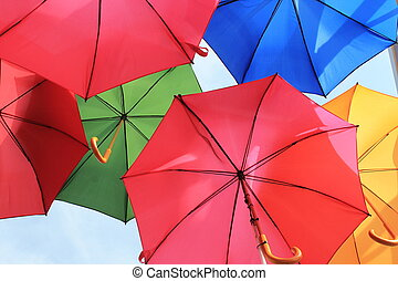 many open and bright, colourful umbrellas
