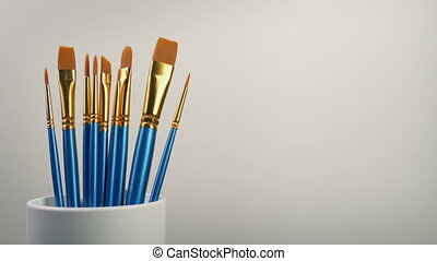Many Paint Brushes By Blank Canvas - Moving slowly past a...