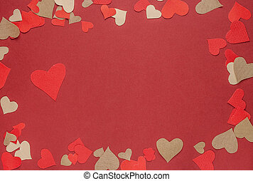 many paper hearts on red background