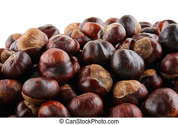 Many peeled chestnuts lie on white background. Isolated