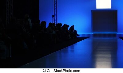 Many people are waiting for beginning of fashion show,...