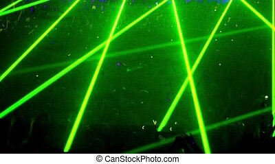 Many people at rave party, green light lazer beam lattice