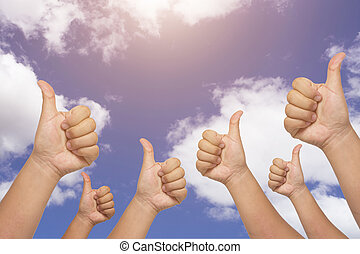 Many people congratulate a winner and holding their thumbs up on blue sky background