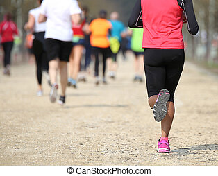 many people during a race and a girl with black leggings