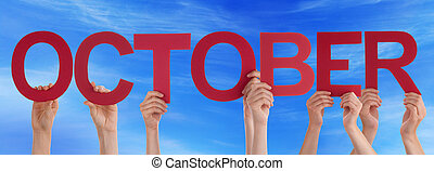 Many People Hands Holding Red Straight Word October Blue Sky