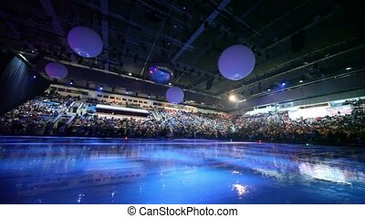 Many people in sport complex wait for begining of ice show, ...