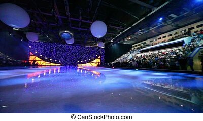 Many people in sport complex wait for begining of ice show,...