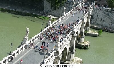many people passing across Sant'Angelo Bridge in Rome - Time...