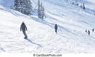 Many People Skiing In Snowfall - Many People Skiing Down...