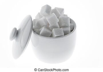 Many pieces of sugar for a sweet isloiert on a white...