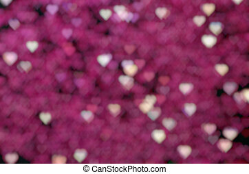 Many pink hearts on dark background.