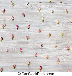 pink rose flower buds on square wooden plank