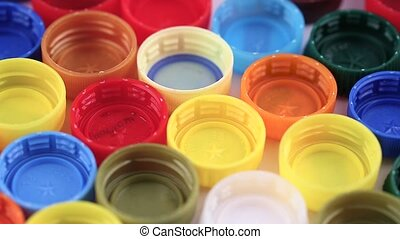 many plastic caps of different colors - many plastic covers...